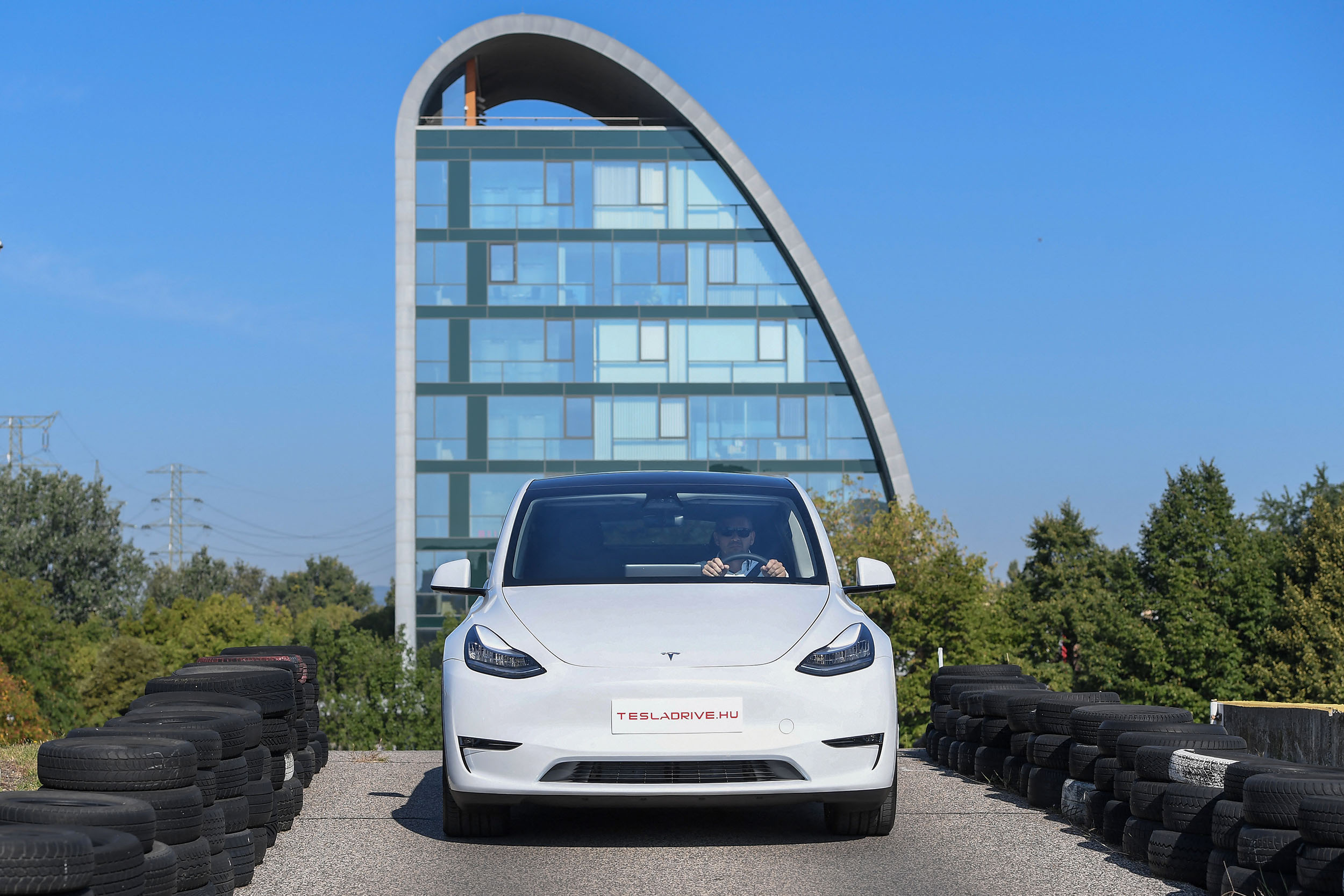 """A picture taken on September 5, 2020 shows a """"Tesla Model Y"""" car, an all-electric compact SUV by US electric car giant Tesla, during its presentation at the Automobile Club in Budapest. (Photo by ATTILA KISBENEDEK / AFP)"""